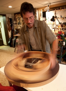 Guitar body spinning on radius dish