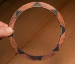 The finished rosette. This will be inlaid to the guitar top. Additional binding strips will be added at installation.