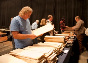 Carl Barney (far right) selling beautiful tonewoods. Photo © Jay Rosenblatt.
