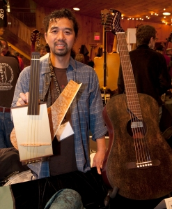 Machihiro Mastuda on two of his concept instruments. Photo © Jay Rosenblatt.