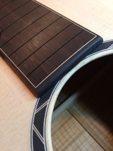 Detail of Ebony fingerboard with Maple inlay strip and Ebony and maple geometric rosette. © Jay Rosenblatt