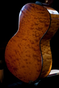 Quilted Maple Parlor Guitar with hand toned amber stain and Nitro Cellulose lacquer. © Jay Rosenblatt