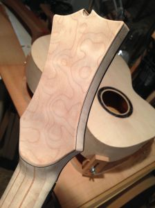 Neck carved and headstock shaped.