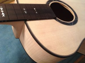 After body assembly the neck is fitted for proper angle and playability.