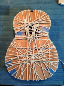 Binding attached with traditional rope system on Ukulele by © Jay Rosenblatt
