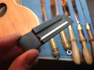 Handmade Ukulele bridge of ebony and bone © Jay Rosenblatt