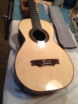 Bridge test fit prior to gluing on Parlor guitar © Jay Rosenblatt