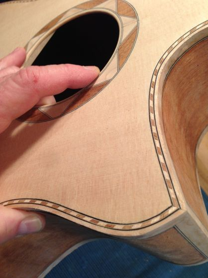 Detail of florentine cutaway and rope binding on aJay Rosenblatt Guitar