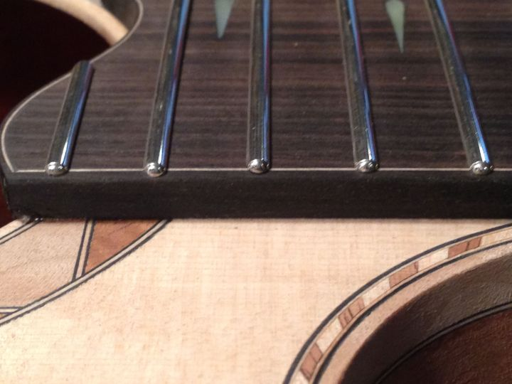 Frets installed after ends are polished