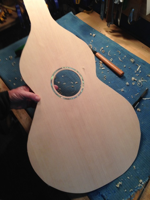 Abalone rosette installed and sound hole cut out