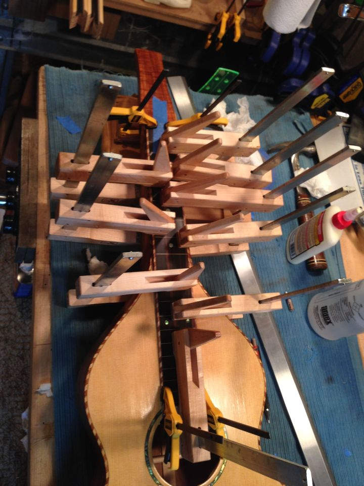 The fingerboard is glued in place and clamped.
