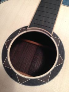 Maple bound Ebony fingerboard with Ebony and Maple Geometric Rosette on a Jay Rosenblatt guitar
