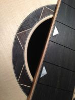 Geometric fingerboard inlay and rosette