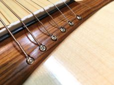 Rosewood and ebony pinless bridge